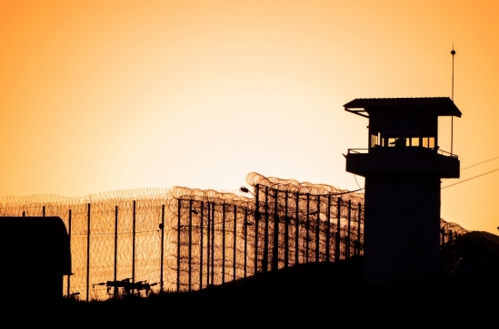 A prison guard tower at sunrise
