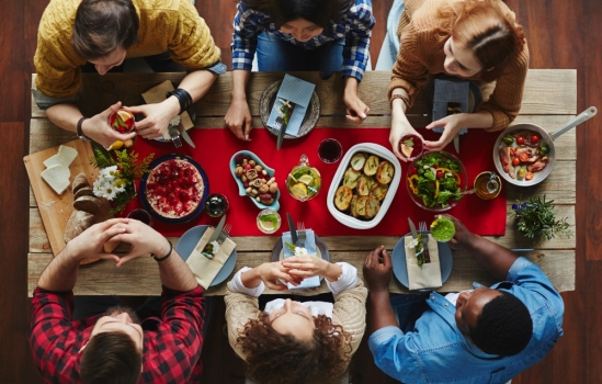 Diverse group of friends around a dining table