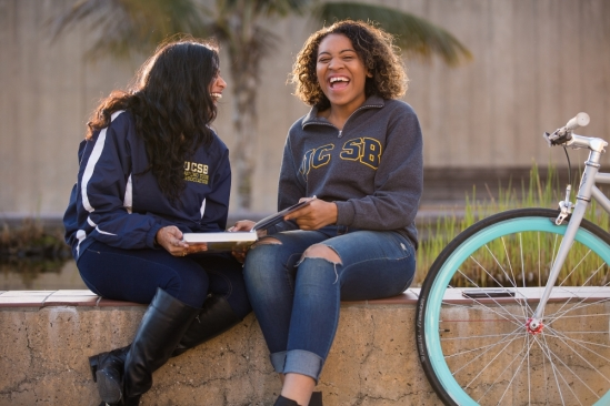 UCSB students laughing at Storke Plaza