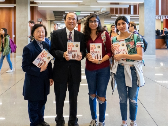 Chancellor and Dilling with students and copies of UCSB Reads 2019 book