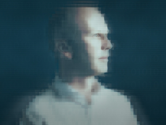 Pixellated image of man blurs the line between man and machine