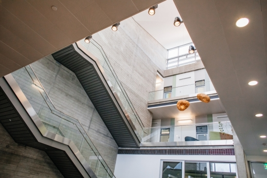 interior courtyard of library building shows study rooms, lamps, clear railings