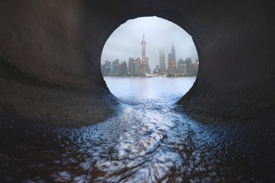 china skyline from drain into the river