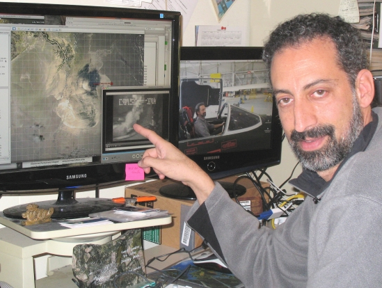 Ira Leifer points to one of the oil spill videos studied by scientists.