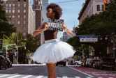 Ballet dancer on point holding Black Lives Matter sign on NYC street