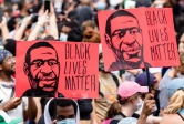 Protestors march to protest police brutality after the killing of George Floyd
