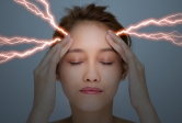 a woman with lightning bolts at temples simulating headache
