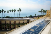 Solar panels line the roof of UCSB's Bren Hall, the first building in the nation to earn a LEED 'Double Platinum' sustainability rating.