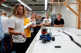 UCSB mechanical engineering students testing a robot