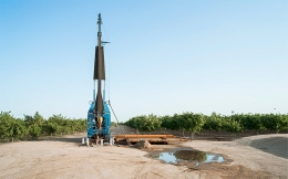 Groundwater well drilling equipment in California's Central Valley.