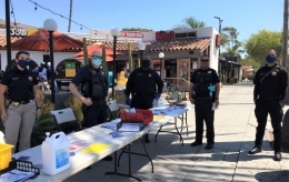 UCPD officers distribute face coverings in Isla Vista