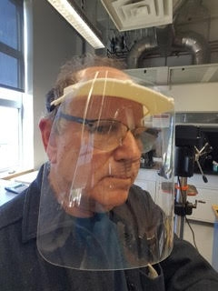 David Bothman models a 3-D-printed face shield