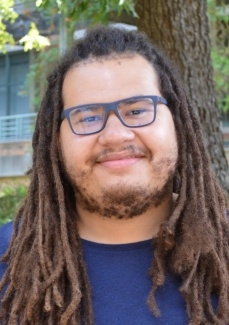 man with glasses and dreadlocks
