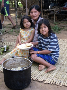 A Tsimane mother and her children