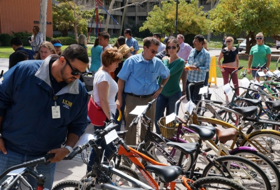 photo of people checking out the bikes