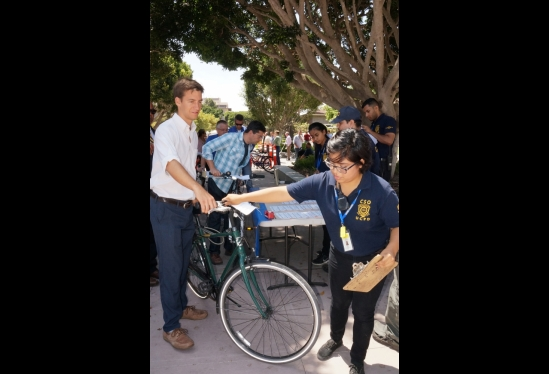 photo of CSO taking bike for registration