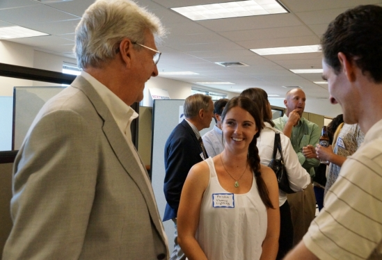 photo of Fluency founders chatting at GEM open house
