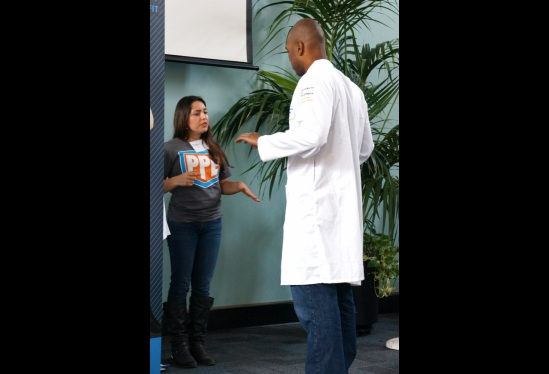 a person getting fitted for a lab coat