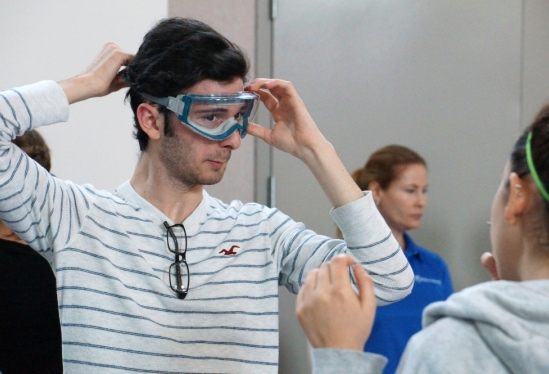 a person getting fitted for protective eyewear