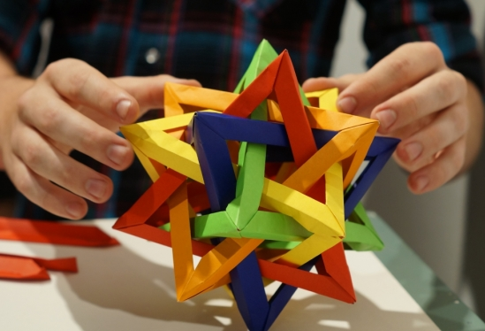 photo of a dodacahedral origami piece