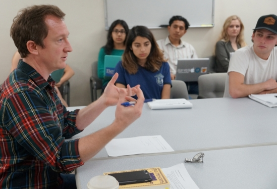 UCSB grad student Chris Walker co-teaching English class