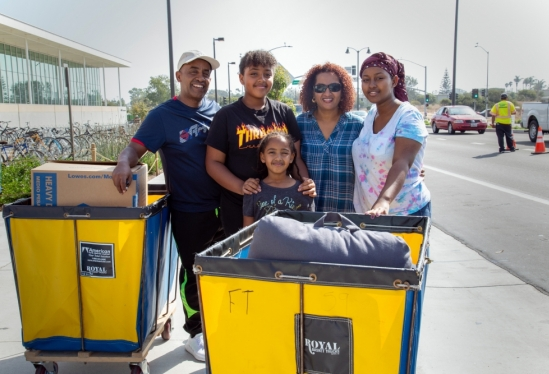 A family helps a new UCSB student with belongings at 2018 Move-In