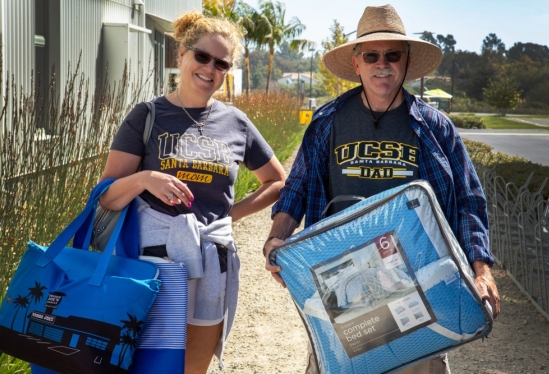 Mom and Dad in UCSB merchandise during 2018 Move-In Weekend