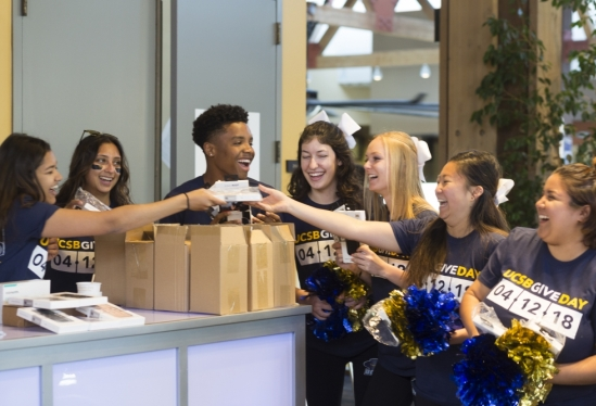 UCSB Give Day 2018 group of student laughing with pompoms