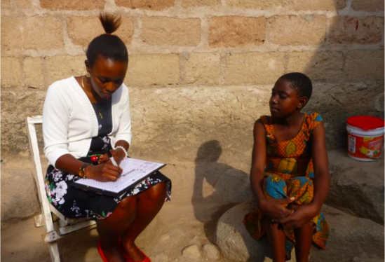 A young girl being interviewed in Tanzania