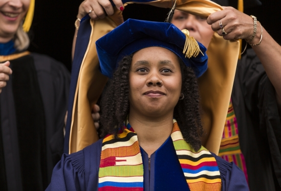 A new Ph.D. is hooded at 2019 Commencement