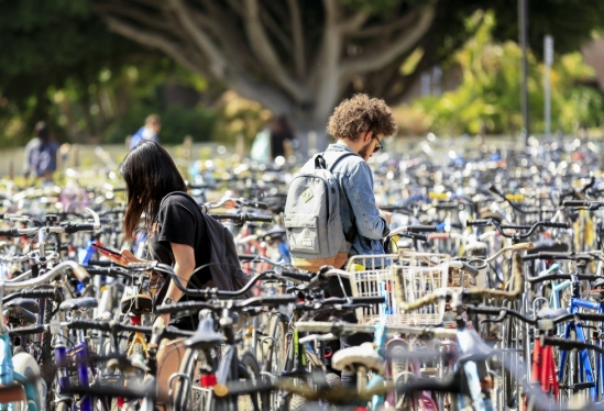 Students amid a sea of bikes at UC Santa Barbara