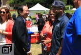 Chancellor Yang chatting with a staff member