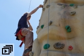 photo of climber on climbing wall