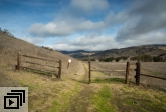 Wooden fence leads to Sedgwick Reserve