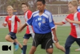 Youth soccer players scrimmage on a UCSB field as part of their day on campus.