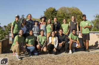 Kim and Jack Johnson with Chancellor Yang and UCSB students at farm