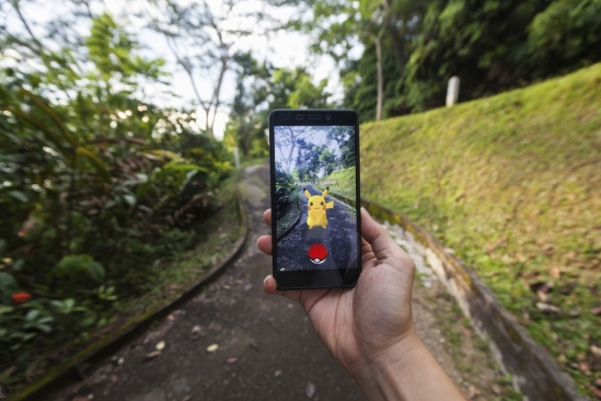 The viral online mobile game Pokémon Go engrosses the world, but who is catching whom?