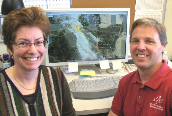 Sandra Seale, left, and Jamison Steidl of UCSB's Institute for Crustal Studies,  with a map pinpointing the Baja earthquake and aftershocks.