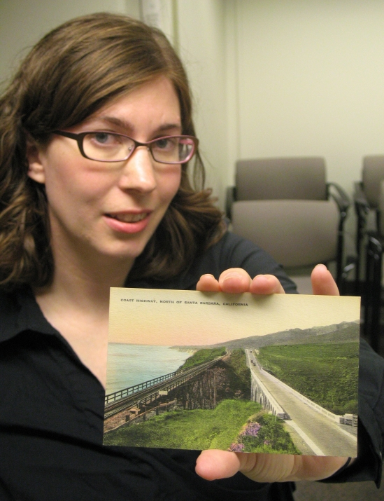 Lisa Koch holds a postcard from the Santa Barbara Historic Postcard Collection.
