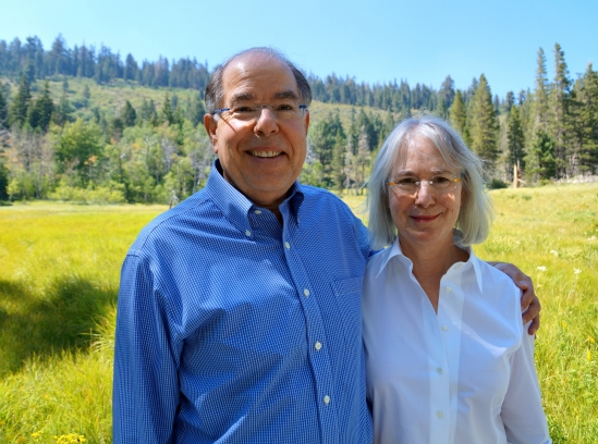 Paul and Kate Page in the meadow at Valentine Camp.