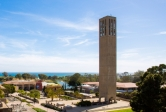 View of campus from above, with Storke Tower and ocean