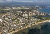 Aerial view of UCSB and Isla Vista from beach up Ocean Road