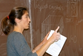 Assistant professor Ania Jayich explains principles of physics to students in an undergraduate course.