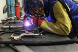 photo of UCSB Mini Baja team member welding