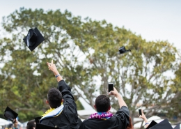 UCSB commencement hats in the air
