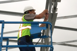 photo of man installing photovoltaic project