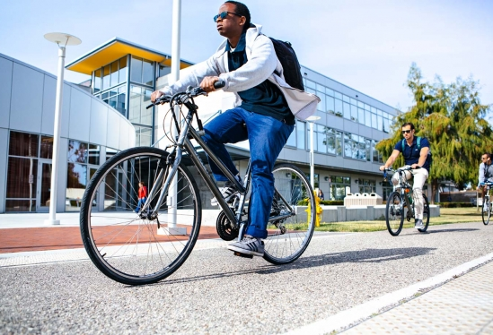 Bicyclists passing the UCSB Student Resource Building