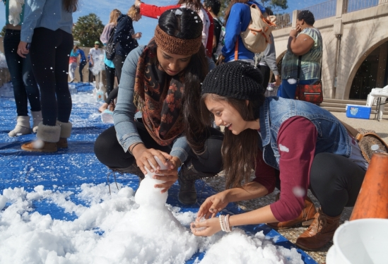 two students making a snowman