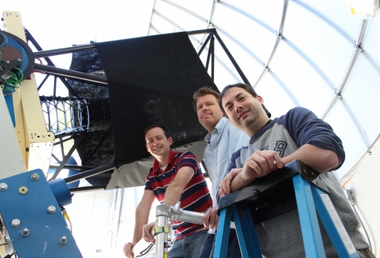 Members of the LCOGT / UCSB supernova team next to an LCOGT 1m telescope. From left to right, postdoc Curtis McCully, faculty member Andrew Howell and postdoc Iair Arcavi.