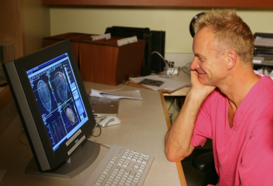 Sting looking at his brain scans